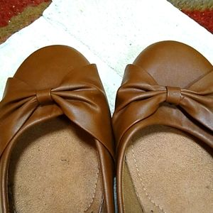 A pair of slip on size 11 tan
